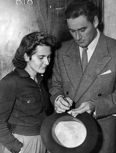 Errol Flynn signing an autograph to a fan (January Old Hollywood Stars, Classic Hollywood, Ethel Waters, Hattie Mcdaniel, Lena Horne, Eartha Kitt, Errol Flynn, Olivia De Havilland, Man Up