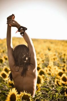 i am naked and surrounded with sunflowers in the warm breeze with my wonderful new man who truly love me