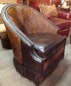 Beautiful croc-embossed leather coupled with soft hair-on cowhide, hand-twisted leather fringe and antiqued nailhead trim accents. The Tulsa Chair swivels and is perfect for the game table, office or as an accent chair in any room. Cowhides are all unique so overall style and color will vary. Made in Texas USA. Allow 10 weeks for delivery.