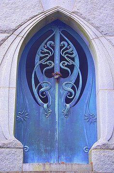 Ornate Art Nouveau-like blue doors