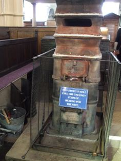 Now that's what you call a WOOD BURNING stove. This stove is installed in St. Hilda's cliff top church, and the sign says it is still in use.