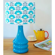 hunkydory home Teal Flower Petals Ceramic Table Lamp ($110) ❤ liked on Polyvore featuring home, lighting, table lamps, teal lamp, ceramic lights, teal lamp shade, teal lights and flower lamp