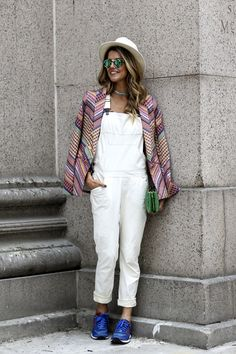 A white jumpsuit and blue sneakers. perfect look for a casual day or a fancy day.
