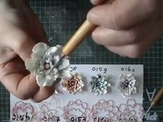 Floral Flourishes 2 - YouTube.   Video is not in English, but the video is easy to understand and follow regardless of what language you speak.    Beautiful use of the Joy! Craft flower dies and the techniques could easily be used for similar brands of flower dies.