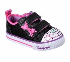 Pack lots of sparkling style into a small treasure with the SKECHERS Twinkle Toes: Shuffles - Itsy Bitsy shoe. Satiny fabric and glitter finish fabric upper in a two strap casual light up sneaker with stitching and overlay accents.