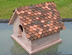 Penny Copper Roof Birdhouse is part of home Garden Floor - My grandmother gave me a box of pennies to cover my bathroom floor some years ago When I decided to sell my home an interesting floor didn't seem like it would… Penny Floor Designs, Penny Table Tops, Copper Roof, Bird Boxes, Ideias Diy, Fairy Houses, Yard Art, Bird Feeders, Backyard