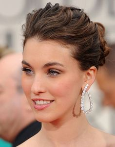 Wedding updo with curly volume in the front