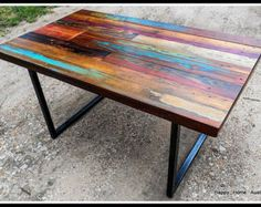 Vibrant shades of blue and green dye make this table one of a kind! Choice of 2x2 or 1x2 square steel legs. Contact me for other leg options.  Dimensions 60x30x30 tall.  ~~~~~~~~~~~~~~~~~~~~~~~~~~~~~~~~~~~~~~~~~~~~~~~~~~~~~~~~~~~~~~~~ My tables are rugged, heavy and durable, and should be enjoyed for many years. They are made from real reclaimed wood, with all of its beautiful imperfections and scars. The result is a hearty, natural feel, and texture. Any acquired imperfections will only…