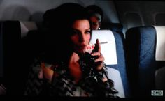 Megan Draper swills some red wine on the way back to LA.