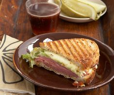Corned Beef Panini with Muenster Cheese and Wilted Cabbage Recipe. Here's a quick and tasty way to get that beloved corned beef and cabbage combination (with melted Muenster as a surprise ingredient) in a toasty sandwich everyone will love.