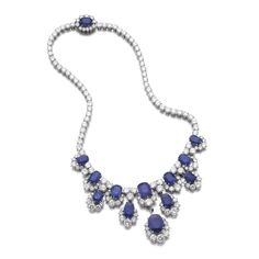 Sapphire and diamond necklace, Van Cleef & Arpels Designed as a line of slightly graduated brilliant-cut diamonds, the front set with cushion-shaped sapphires highlighted with brilliant-cut diamonds, supporting five detachable motifs similarly set, length approximately 380mm, unsigned, numbered, French assay marks, French maker's mark for Van Cleef & Arpels. ||| sotheby's