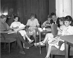 The VonTrapp family kids (sans the oldest child Charmian Carr who played Liesl, with their dialog coach working on perfecting British accents they all needed for the film - Sound of Music. The dialog coach was Pamela Denove. This is at 20th Century Fox studios in Los Angeles.