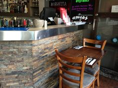 This Rustic #cladding looks great as a feature wall on this Acland street restaurant.