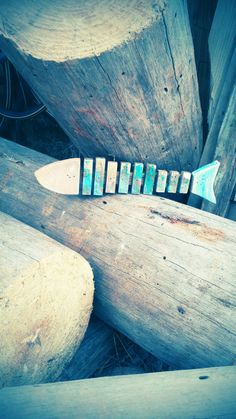 This Handmade mini fish is adorable, Handmade wooden fish with bones Unique gift or for your own home He is hand cut, handmade and hand painted using reclaimed vintage barn wood He is cool alone or with his fish buddies (available in our listings or custom made)   Hang or sit this listing is approx 2 1/2 x 12  Our signs are handmade, hand cut and hand painted on reclaimed vintage wood. Each sign is distressed for a look that brings out its individual character.  Perfection is not always…