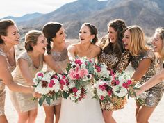 A fun bridal party photo showing off the bouquets! Randy + Ashley, Palm Springs and Southern CA Wedding Photographers.