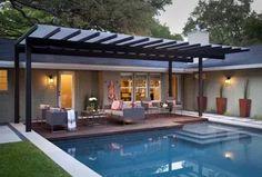 Steel overhead pergola at pool