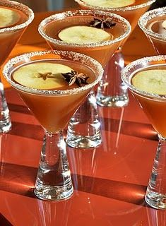 Apple Crisp Cocktails - a shot of vodka, shots of fresh apple cider and shot pomegranate juice and a squirt of lemon. Rim lined with lemon and dusted with sugar and cloves. Apple slice and star anise to decorate. Holiday Drinks, Party Drinks, Fun Drinks, Yummy Drinks, Alcoholic Drinks, Beverages, Halloween Drinks, Cocktails, Cocktail Drinks