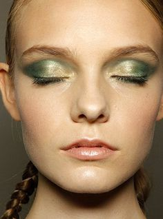 Shimmery green iridescent lids with a touch of yellow for a beautiful makeup look.
