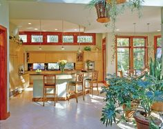 Kitchen of Featured Green Home: I wouldn't mix the woods, but the floor plan is nice. Maybe stained concrete and rustic wood, instead?