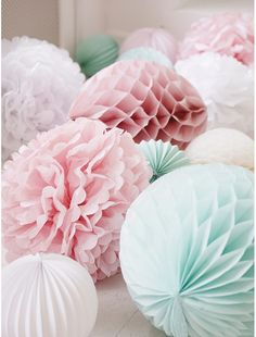 With spring already here, there are so many pastel baby shower themes that you can throw for a mom who is expecting this season.Take a look at these pastel spring baby shower decorations, invitations and more to celebrate the season and the mom-to-be >> Pastell Party, Deco Pastel, Pastel Paper, Pastel Decor, Wedding Pom Poms, Shades Of White, Pretty Pastel, Paper Decorations, Pastel Party Decorations