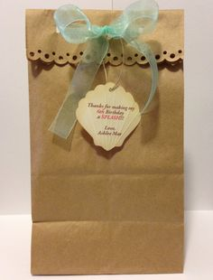 Party favor bags with a personalized seashell tag for mermaid / beach theme party on Etsy, $12.95