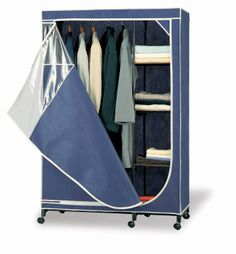 For portable storage and organization of your off-season clothing, this rolling storage armoire fits the bill. This wardrobe with zippered door holds lots of clothing and has a rack with four shelves for folded sweaters or other items. Portable Wardrobe, Wardrobe Storage, Closet Storage, Closet Organization, Wardrobe Rack, Ikea Wardrobe, Closet Drawers, Attic Storage, Clothing Storage