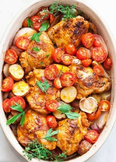 One-pan chicken dinner with potatoes, onions, garlic, cherry tomatoes, and an easy paprika sauce. Dairy-free, gluten-free. 1 hour start to finish!