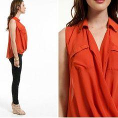 In a Twist Top 100% polyester. Burnt Orange. Gold tone pyramid stud collar detail. Chiffon-like. Tobi Tops