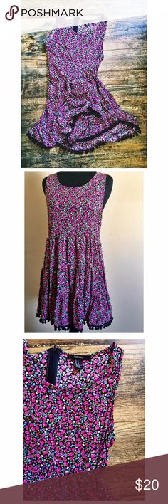 Forever 21 baby doll dress Has the cutest Pom-poms hanging off bottom of dress. One of my fav dresses ever owned! Great comfortable material. I'm 5 5' and it hits above knee Forever 21 Dresses Mini