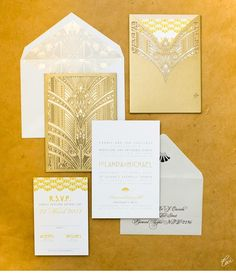 White and Gold Wedding.  Gold laser cut art deco invitations or cards - so fancy looking!