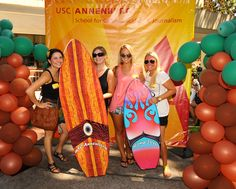 Life-size surfboard cutouts and palm tree balloon towers | California Dreamin' @ Annenberg.