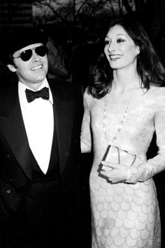 Anjelica Huston   Acting super-couple Anjelica Huston and Jack Nicholson walked the red carpet together at the 1974 Academy Awards with Anjelica choosing a white lace gown for her Oscars styling. (1974)