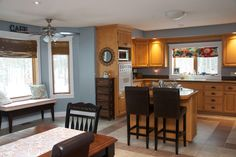 Oak Kitchen with Blue/Grey Wall color. Kitchen reno is not in the cards right now so I had to pick a great color to go with Oak cabinets.. Blue/Grey works..