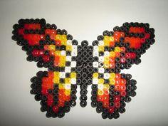 Papillon rouge et jaune en perles à repasser- Création réalisée par : isabelle8119