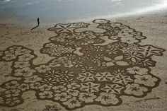 Artist Uses a Rake to Create Amazingly Surreal and Enormous Sand Paintings