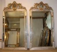Pair of 19th century arched margin mirrors with etched silver leafed and cream gesso frames and wide cartouches of pair of cherubs each side of central oval glass. Original mirror plates with some age. Also original board backs.