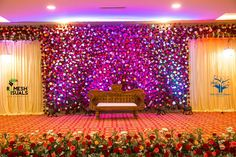 With fully bloomed roses bordering the stage , the majestic couch opens it's arms for the cute couple to ascend their life's first step ! Reception Stage Decor, Wedding Backdrop Design, Wedding Stage Design, Wedding Hall Decorations, Wedding Reception Backdrop, Marriage Decoration, Flower Wall Wedding, Flower Decoration, Backdrops