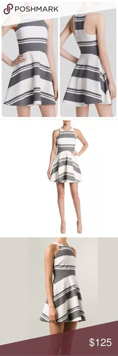 ELIZABETH and JAMES MAGDALENA RACERBACK Dress 4 ELIZABETH AND JAMES Striped Magdalena Fit and Flare RACERBACK Dress Retails: $365.00 Size: 4 Grey and Ivory Frame your figure in the fit-and-flare silhouette of this Elizabeth and James dress. The flattering piece works modern-meets-classic style w neutral heels & minimalist accessories. • Polyester/viscose/elastane • Dry clean Round neck, sleeveless, fit-and-flare skirt, concealed back zip closure, lined. New with tags attached. Small scratch…