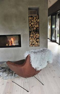 Kamin-Raumteiler Kamin-Raumteiler inspired by the project: Robust and stylish. Exclusive photos and the story. Living Room With Fireplace, Living Room Decor, Butterfly Chair, Fireplace Design, Interior Exterior, Interior Design Living Room, Interior Inspiration, House Design, Home Decor
