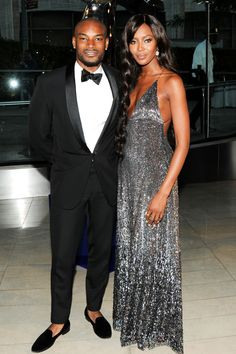 Tyson Beckford and Naomi Campbell….hate it Tyson.shoes with no socks wearing a tux…
