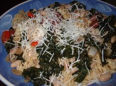 "Macaroni With Kale and White Beans from Food.com:   								This delicious vegetarian meal is packed with nutrients.  If you've never tried kale, this is a good recipe to try!  Kale tastes similar to spinach but retains its leafy texture.  From Jeanne Lemlin's ""Main Course Vegetarian Pleasures."""