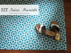 DIY water-resistant fabric floor mat. This would be perfect to cover up ugly rental kitchen and bathroom floors!