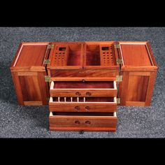 custom built wooden fly tying box with thread storage, tool holder and rainbow trout shoulder strap