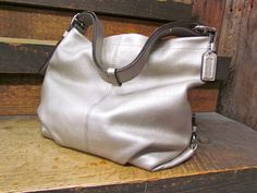 Coach Purse... Carrying this exact bag now... The more I wear it the more I love the leather!
