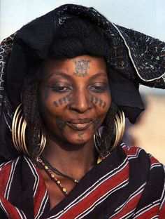 Africa   Wodaabe woman with traditional facial tattoos.  Niger, Sahara   © Angela Fisher, Africa Adorned.  London: Collins, 1984.
