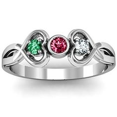 One day this will be my ring with mine nd my husbands birthstones on each nd our little ones in the middle!! Cant wait for that day :)