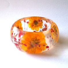 Red and Yellow Botanical Resin Bangle.  Chunky Bangle with Pressed Flowers.  Real Flowers - Red Baby's Breath and Yellow Cosmos.. $44.00, via Etsy.