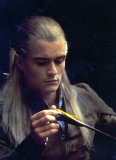 The reason I know this wasn't in the movies is because Legolas is actually making more arrows