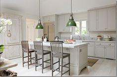 White kitchen. Green light pendants.