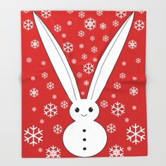 The perfect winter blanket and Christmas gift featuring a very cute bunny and snowflakes design!